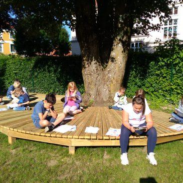 Lesestunde im Stadtpark| Branje v parku